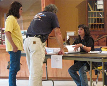 Town Clerk Patti Lewis talks with voters on election day.
